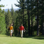golf players walking